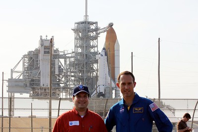 Craig with astronaut Jim Newman, in front of Space Shuttle Atlantis on Launch Pad 39-A