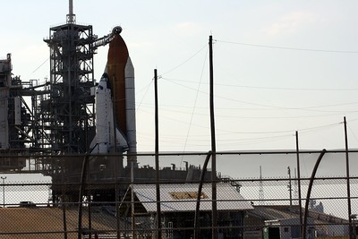Space Shuttle Atlantis on Launch Pad 39-A (foreground, left), with Space Shuttle Endeavour on Launch Pad 39-B (background, right) in case a rescue mission is needed