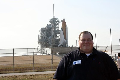 Chris in front of Space Shuttle Atlantis on Launch Pad 39-A
