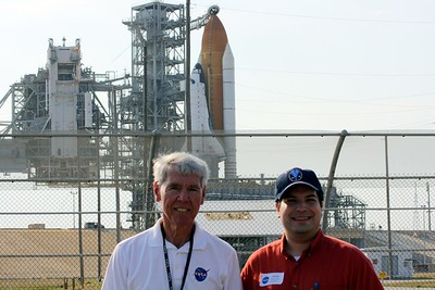 Craig with guide Chuck Kleinschmidt, in front of Space Shuttle Atlantis on Launch Pad 39-A