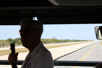 Driving next to the Crawlerway with our guide, Chuck Kleinschmidt, with Space Shuttle Atlantis on Launch Pad 39-A in the background