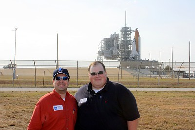 Craig and Chris in front of Space Shuttle Atlantis on Launch Pad 39-A