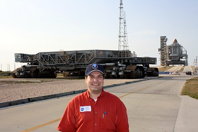 Craig in front of Space Shuttle Endeavour on Launch Pad 39-B, with the Crawler-Transporter in between