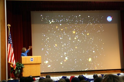 Dr. Laurie Leshin, Deputy Center Director for Science & Technology at NASA Goddard Space Flight Center, shows the Hubble Ultra Deep Field image, created from photos taken by the Hubble Space Telescope over a four-month period.  As viewed from Earth, the area represented in the photo is the size of the eye of a needle, and contains an estimated 10,000 galaxies.
