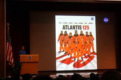 Dr. Laurie Leshin, Deputy Center Director for Science & Technology at NASA Goddard Space Flight Center, shows a promotional poster for the crew of STS-125