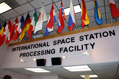 Entrance to the Space Station Processing Facility, showing the flags of the countries that have contributed parts to the International Space Station