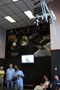 A NASA official describes a model of the International Space Station