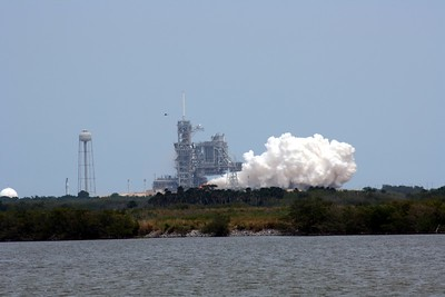 Launch Pad 39-A, T minus 2 seconds to liftoff.  The Space Shuttle Main Engines (SSMEs) have ignited, flashing the water from the sound suppression system into the signature steam (not smoke) of a Shuttle liftoff.