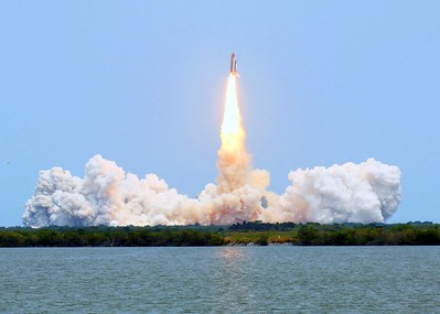 Atlantis clears the tower, T plus 9 seconds after liftoff from Launch Pad 39-A