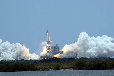 Atlantis rises from Launch Pad 39-A, T plus 3 seconds after liftoff