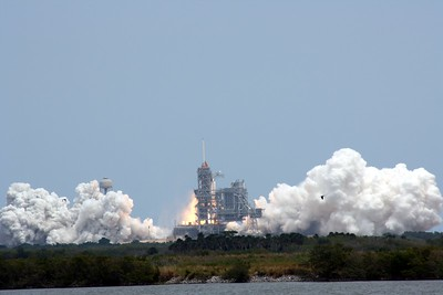 Launch Pad 39-A, T plus 1 second after liftoff.  The Solid Rocket Boosters (SRBs) have ignited.