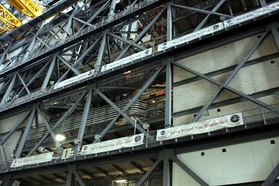 The personnel at the Vehicle Assembly Building sign a banner for each mission they support