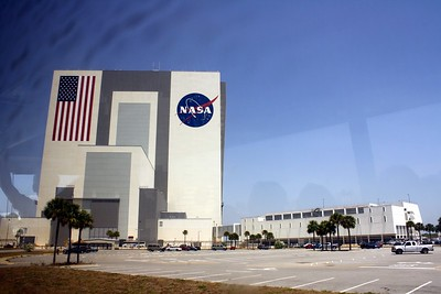 On the left is the Vehicle Assembly Building, the largest one-story building in the world.  On the right is the back of the Launch Control Center (LCC).