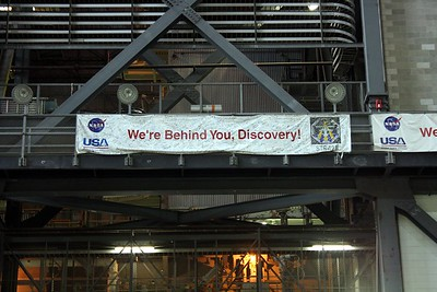The personnel at the Vehicle Assembly Building sign a banner for each mission they support.  This banner is for STS-121 on Space Shuttle Discovery.