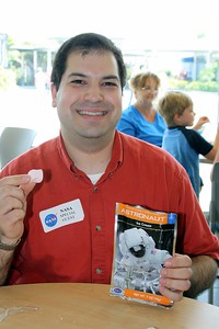 Craig samples some astronaut ice cream in the Orbit Café.  Real astronauts actually eat regular ice cream.