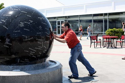 Craig spins the Constellation Sphere, a nine-ton granite map of the stars