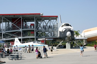 A mockup of the Space Shuttle system, including an orbiter called Explorer, external fuel tank, and solid rocket boosters.  On the left is a T-38 Talon, used by NASA as an astronaut trainer and chase plane.