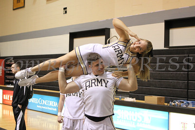 An Army cheerleader (Caitlin Adamowicz) is raised high in the air (by Logan Phillips) to energize the crowd during the Army Black Knight Men's Basketball game against the Bucknell Bison, at West Point's Christl Arena on Saturday, January 31, 2009