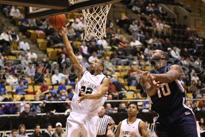 The Army Black Knight Men's Basketball team won against Bucknell Bison, 76-65, at West Point's Christl Arena on Saturday, January 31, 2009. Army's Julian Simmons (#22) drives to the basket as Bucknell's Justin Castleberry (#10) defends.
