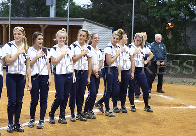 Newburgh Free Academy softball players stand along the third base line during the singing of the Star Spangled Banner during their final home game on Wednesday, May 27, 2009.
