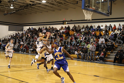 Newburgh Free Academy Boys Varsity Basketball team took on Bishop Maginn on Saturday, January 3, 2009 at Mount Saint Mary College in Newburgh, NY. The NFA Goldbacks were victorious over the Griffins, with the final score 71-56.