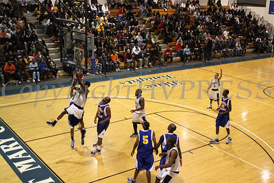 Newburgh Free Academy's Damon Cousar (#5) puts up two against Bishop Maginn on Saturday, January 3, 2009 at Mount Saint Mary College in Newburgh, NY. The NFA Goldbacks were victorious over the Griffins, with the final score 71-56.