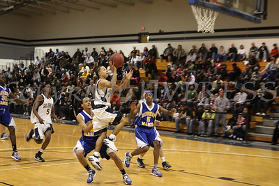 Newburgh Free Academy's Marcus Henderson (#3) puts up two points against Bishop Maginn on Saturday, January 3, 2009 at Mount Saint Mary College in Newburgh, NY. The NFA Goldbacks were victorious over the Griffins, with the final score 71-56.