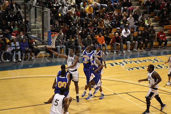 Newburgh Free Academy's Michael McCleod (#4) puts up two against Bishop Maginn on Saturday, January 3, 2009 at Mount Saint Mary College in Newburgh, NY. The NFA Goldbacks were victorious over the Griffins, with the final score 71-56.