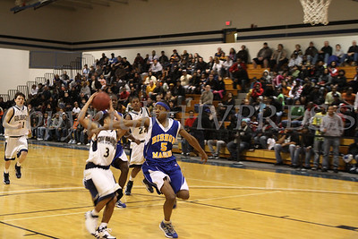 Newburgh Free Academy's Marcus Henderson (#3) works past Bishop Maginn's Jerel Scott (#5) during their game on Saturday, January 3, 2009 at Mount Saint Mary College in Newburgh, NY. The NFA Goldbacks were victorious over the Griffins, with the final score 71-56.