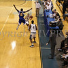 Newburgh Free Academy's Marcus Henderson (#3) passes the ball to Michael McCleod (#4) as a flying Shavar Fields (#15) defends during their game on Saturday, January 3, 2009 at Mount Saint Mary College in Newburgh, NY. The NFA Goldbacks were victorious over the Griffins, with the final score 71-56.