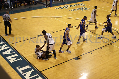Newburgh Free Academy's Octavius Fraser (#42) helps up a team mate during the Boys Varsity Basketball game against Bishop Maginn on Saturday, January 3, 2009 at Mount Saint Mary College in Newburgh, NY. The NFA Goldbacks were victorious over the Griffins, with the final score 71-56.