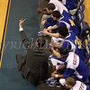 Bishop Maginn coach Rich Hurley gives his players a signal during their game against Newburgh Free Academy on Saturday, January 3, 2009 at Mount Saint Mary College in Newburgh, NY. The NFA Goldbacks were victorious over the Griffins, with the final score 71-56.