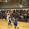 Newburgh Free Academy's Marcus Henderson (#3)puts up two against Bishop Maginn on Saturday, January 3, 2009 at Mount Saint Mary College in Newburgh, NY. The NFA Goldbacks were victorious over the Griffins, with the final score 71-56.