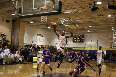 Newburgh Free Academy's Michael McCleod (#4) soars through the air prior to dunking the ball in the final seconds of the game against Monroe Woodbury Thursday, January 8, 2009 at Newburgh Free Academy in Newburgh. NFA defeated Monroe Woodbury 65-54.