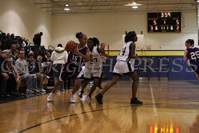 Monroe Woodbury's Alexis Billups (#15) is guarded by Newburgh Free Academy's Tara Bryant (#23) during the Friday, January 9, 2009 game at Newburgh Free Academy in Newburgh, NY. Monroe Woodbury defeated NFA, 50-37