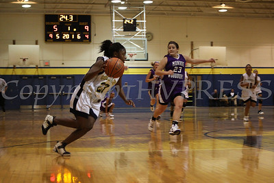 Newburgh Free Academy's Tara Bryant (#23) drives towards the paint during the Friday, January 9, 2009 game against Monroe Woodbury at Newburgh Free Academy in Newburgh, NY. Monroe Woodbury defeated NFA, 50-37
