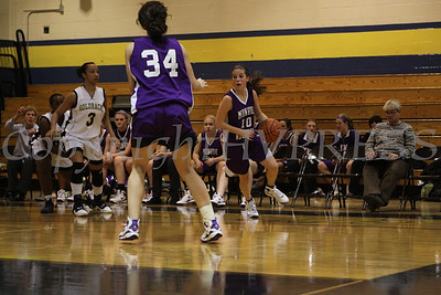 Monroe Woodbury's Stephanie Burke (#10) works her way out of a double team during the game against Newburgh Free Academy on Friday, January 9, 2009 at Newburgh Free Academy in Newburgh, NY. Monroe Woodbury defeated NFA, 50-37