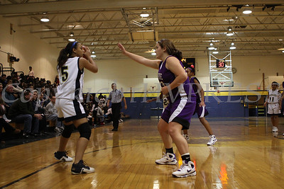 Newburgh Free Academy's Jolene Arroyo (#5) is guarded by Monroe Woodbury's Kaitlyn Doyle (#23) during the Friday, January 9, 2009 game at Newburgh Free Academy in Newburgh, NY. Monroe Woodbury defeated NFA, 50-37