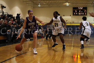 Newburgh Free Academy's Leondrea Lee (#21) defends against Monroe Woodbury's Carry Collins (#12) during the Friday, January 9, 2009 game at Newburgh Free Academy in Newburgh, NY. Monroe Woodbury defeated NFA, 50-37