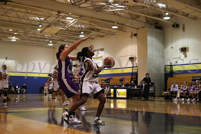 Newburgh Free Academy's Tara Bryant (#23) drives gets past monroe Woodbury's Kaitlyn Doyle (#23) during the Friday, January 9, 2009 game at Newburgh Free Academy in Newburgh, NY. Monroe Woodbury defeated NFA, 50-37