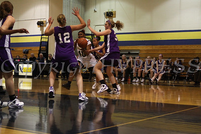 Newburgh Free Academy's Shedarian Daniels (#40) is tripple teamed by Monroe Woodbury's Cary Collins (#12), Danielle Waldron (#31) and Alexis Billups (#15) during the Friday, January 9, 2009 game at Newburgh Free Academy in Newburgh, NY. Monroe Woodbury defeated NFA, 50-37