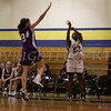 Newburgh Free Academy's Tyra Bryant (#23) shoots a three-pointer while Monroe Woodbury's Emily Niebor (#34) defends during the Friday, January 9, 2009 game at Newburgh Free Academy in Newburgh, NY. Monroe Woodbury defeated NFA, 50-37