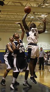 Newburgh Free Academy Boys Varsity Basketball hosted Pine Bush on Tuesday, January 10, 2009 at Newburgh Free Academy in Newburgh, NY. NFA defeated Pine Bush 71-51. NFA's Octavius Fraser (#42) shoots over Pine Bush's Antoine Long (#20).