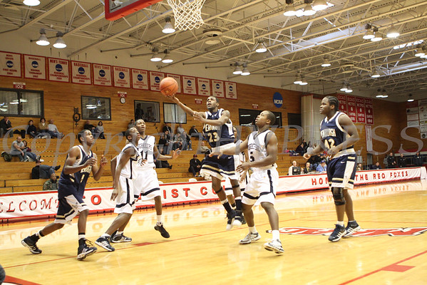 Newburgh Free Academy's Myron Johnson (#23) lays up two points against Poughkeepsie High School on Saturday, January 10, 2009 at Marist College in Poughkeepsie, NY. Poughkeepsie defeated NFA 74-70.