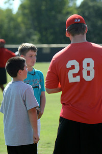 Baseball activities with children in the community; September 07, 2009.