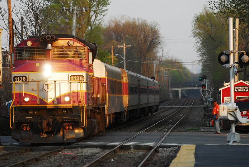 An outbound Lowell line train at West Medford.