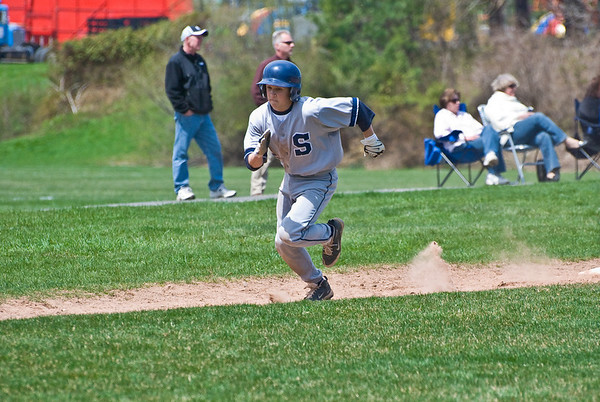Mike Scott (2nd baseman, #2) scores the first run for Staples.