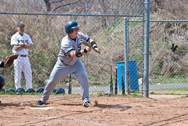 Mike McGowan (catcher, #24) at bat, attempts to bunt