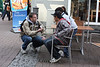 Bill Pyne of Hannover International Bible Church witnesses to youths in Celle, Germany during a street evangelism event.