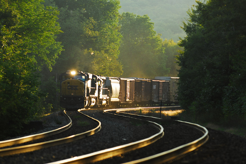 CSX Q436 drifts downhill past Middlefield Station in last light of September 4, 2009.
